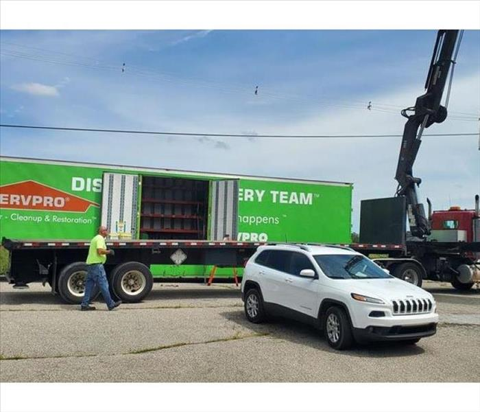 SERVPRO semi and jeep outside commercial loss