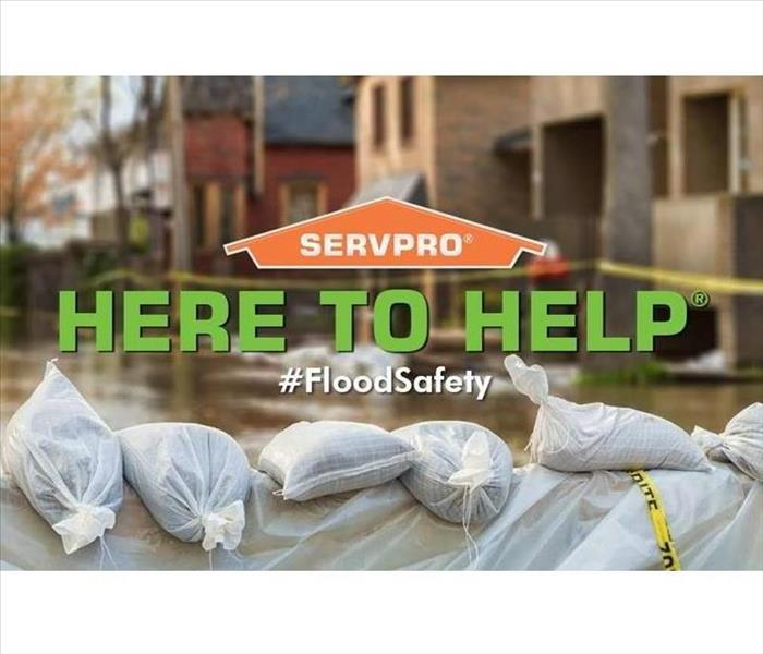 "Overview of flood with ""Here to Help"" and SERVPRO logo"