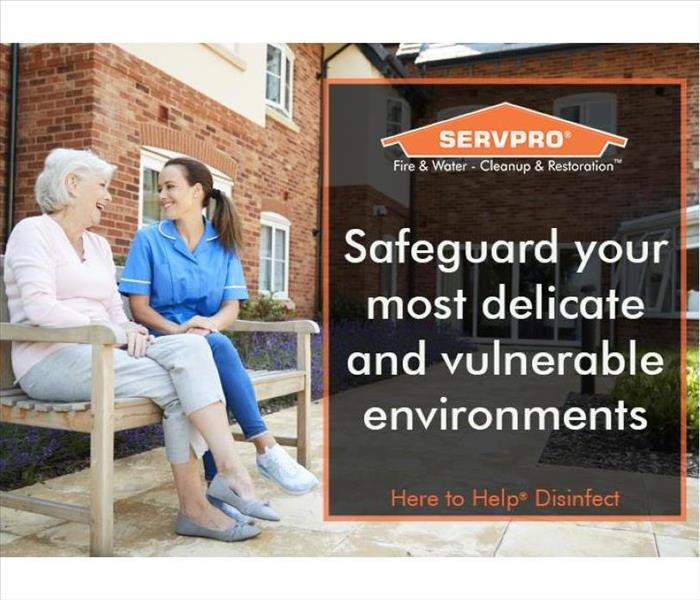 Nurse and senior citizen sitting on a bench outside assisted living facility