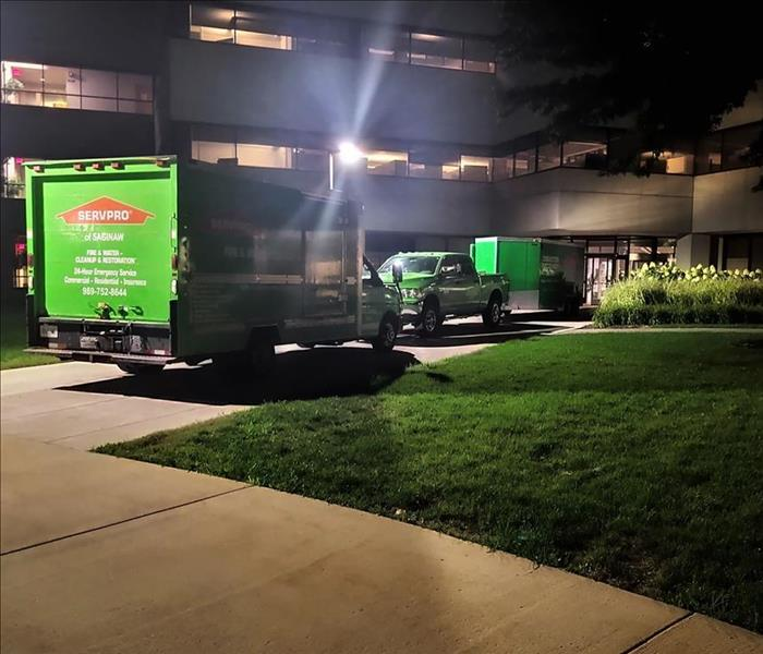 SERVPRO trucks outside commercial building