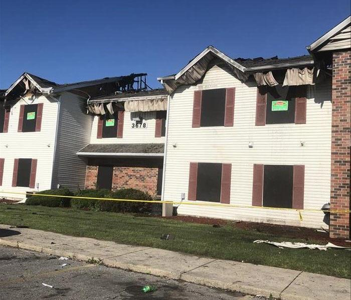 Board up services after fire damage at apartment complex