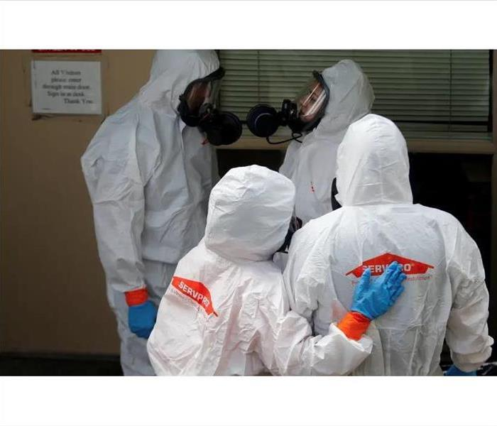 SERVPRO employees getting ready to clean facility in full disinfectant gear