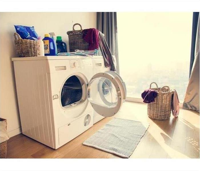 Open Washing Machine in Clean Laundry Room